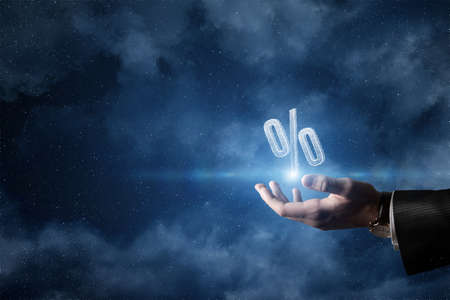 Space discount concept. Hand shows hologram percentages on outer space background.