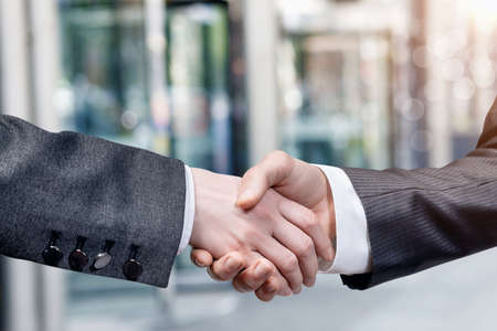 Businessmen shaking hands. Concept of cooperation and contracting in business.