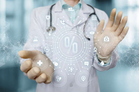Medical services discount concept. Doctor showing a hologram percent blurred background.
