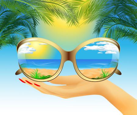 sunglasses reflection: Sunglasses with the reflection of the summer sea landscape lie on hand