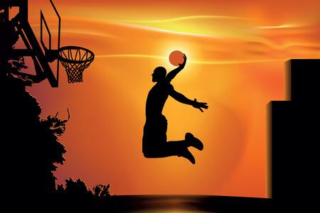 atleta jugando al baloncesto en la calle al atardecer