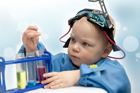 Boy doing experiments at the lab photo