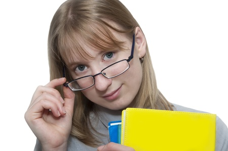 Cute young attractive student girl holding colorful exercise books photo