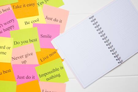 Motivational words on colorful stickers on white background. A vision Board. Copy space. Cards with words. Affirmation, development, training, seminar. Plan, strategy, to-do list, concept. Creativity, Stock Photo