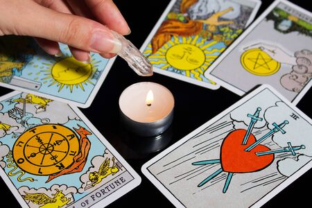 Tarot card reading. Christmas divination, ritual, rite. Magical crystal, candle. Predicting the future. Love spell. Witchcraft, magic.