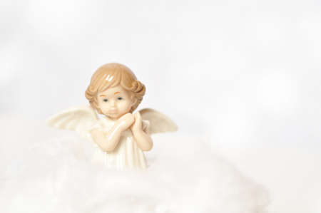 cute little angel in the sky with white clouds Foto de archivo