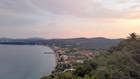 Survey panorama of the island of Corfu in Greece. Top view. Summer landscape of the beach, sea, mountains and houses.. For use in a web design, calendars, posters, posters.