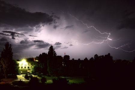 Lightning during night thunderstorm. on city photo