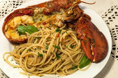 Lobster with spaghetti on white plate   photo