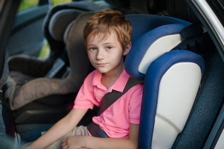 boy sits in a car seat