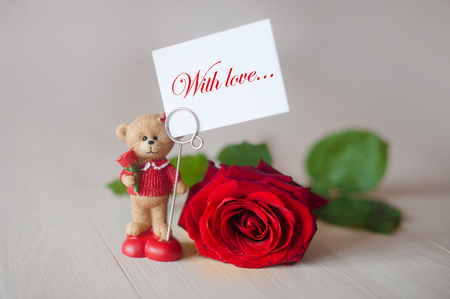 Teddy bear with a beautiful pink rose. Stock Photo