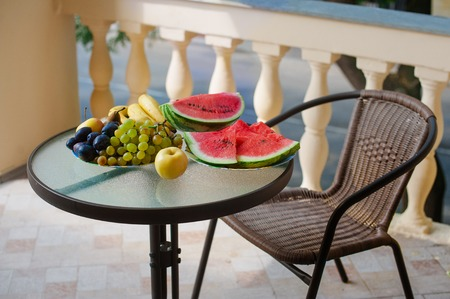 elegant mediterranean terrace with fruit and floewr bawl