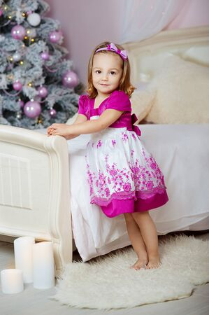 Funny baby girl in Christmas living room. Xmas holiday concept
