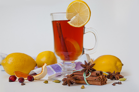 mulled wine in a glass of Irish with lemon, cinnamon, cumin decorated Stock Photo