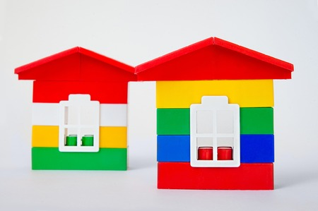 Two toy houses from the designer on a white background. building concept.
