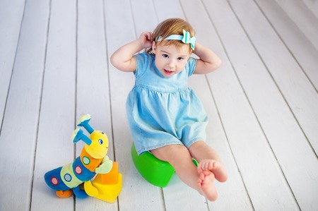 baby on potty play - learning to use toilet