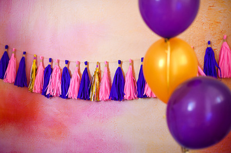 wedding feast: Garland on a painted background with multi-colored balloons
