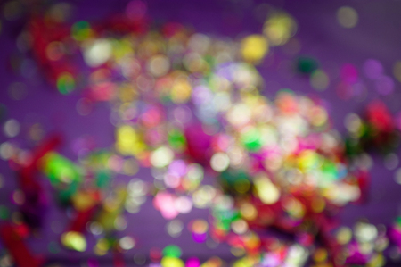 concept of holiday. background is out of focus. colored confetti Stock Photo