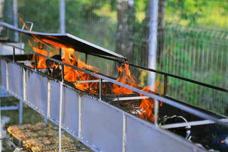 Empty Barbecue Flaming Charcoal Grill With Bright Flames Of Fire