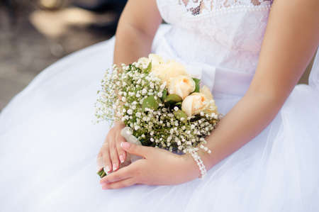 wedding dress: Bride holding her pink and white roses bouquet