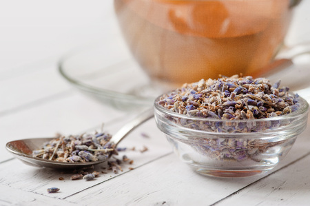 Aromatic lavender tea and bunch of dried lavender. Toned image Stock Photo