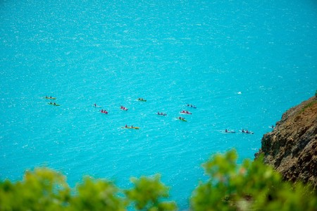 Top view of kayak boat oin shallow turquoise water