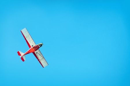 Cheerful small plane in the blue sky Stock Photo