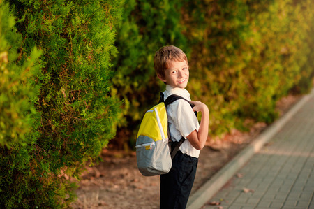 First day at school. Elementary Student, Little Boys, Backpack. Stock Photo