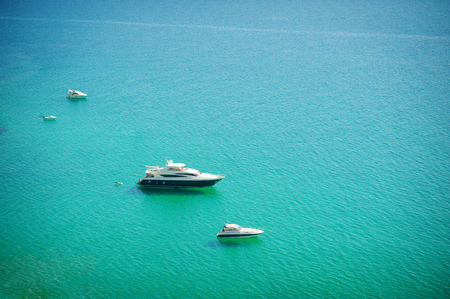 Sailing ship yachts with white sails in a row. Aerial view. Luxury Cruise Sailing in the open sea
