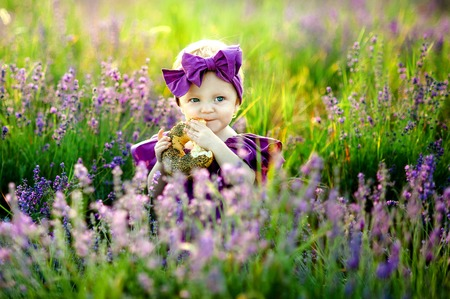 Little girl playing in nature at sunset. Selective focus and small depth of field.