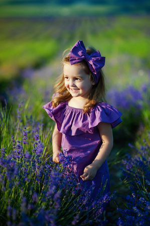 Cute little girl on the meadow in spring day. concept of childhood, health