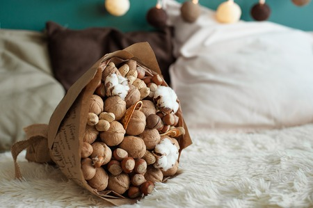 Delicious and healthy bouquet, composition of walnut and hazel, excellent gift for all occasions, concept of healthy lifestyle