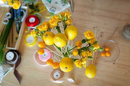 Floristics hobby. Floral and fruits bouquet making process. Stockfoto