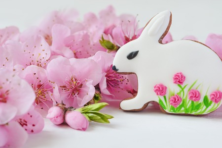 easter concept. gingerbread bunny surrounded by spring flowers