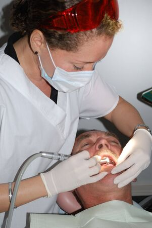 The Medical treatment at the dentist office photo