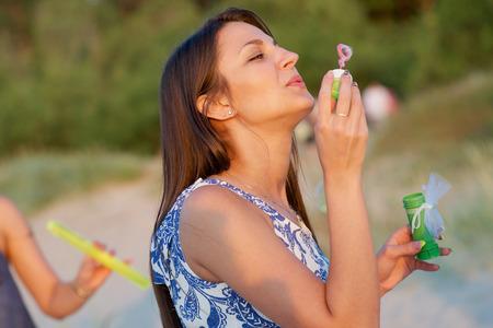 midsummer: Summertime, midsummer. Cute girl outdoor
