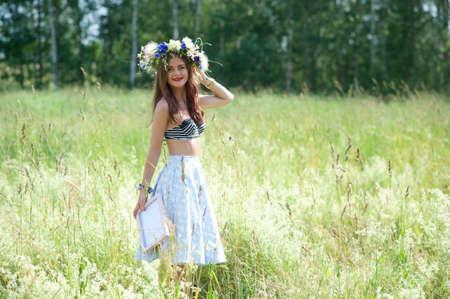 Summertime, midsummer. Cute girl outdoor