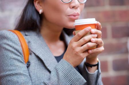 hot secretary: Business, fashion. Woman coffee cup on the street