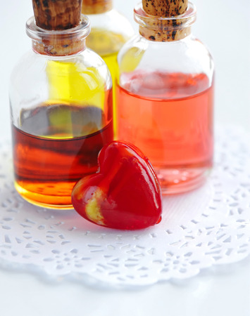 Essential oils are with a decorative heart. Aromatherapy