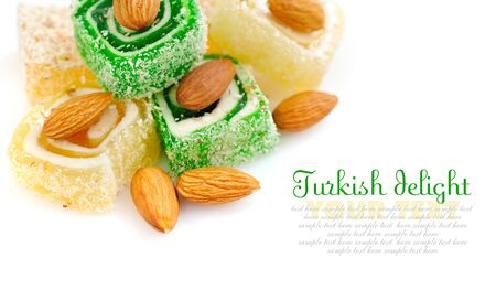 Tasty Turkish delight with almond on white background