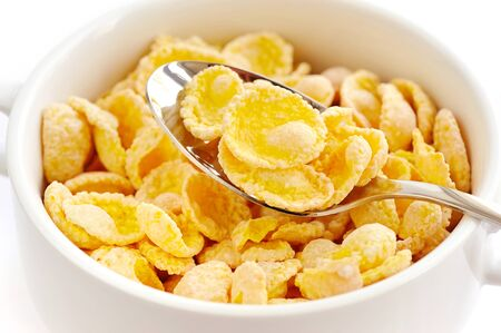cornflakes: Cornflakes in a white bowl