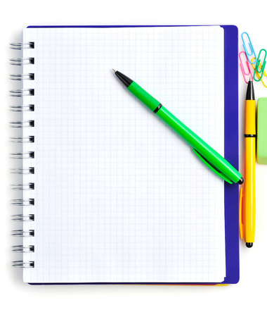 rubber sheet: Notebook with color pens on a white background