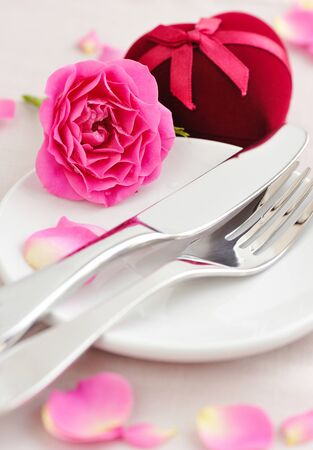 Romantic table setting with pink roses photo