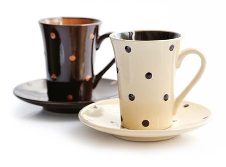 saucers: Coffee cups and saucers isolated on white