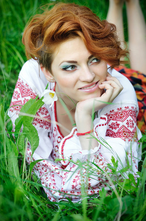 national costume: Young beautiful woman in the Ukrainian national costume Stock Photo