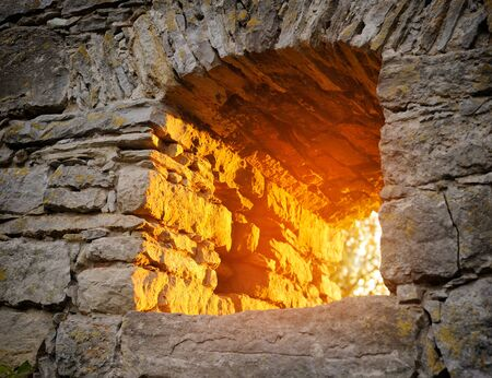 embrasure: Sunbeams are in the loop-hole of old fortress