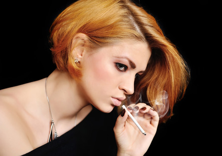 redheaded: Portrait of beautiful redheaded girl that smokes