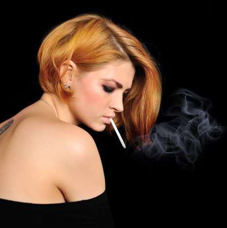 redheaded: Portrait of beautiful redheaded girl with cigarette Stock Photo