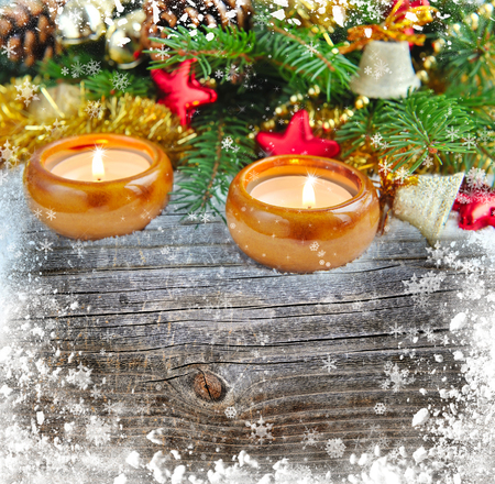snowbound: Christmas composition is with candles on a snowbound wooden background Stock Photo