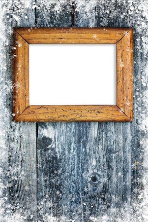 snowbound: Old frame on snowbound wooden background